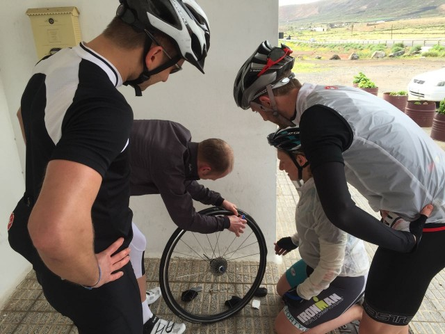 How many triathletes does it take to fix a puncture?